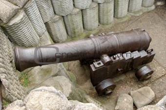 antique gun installed in a recess of the fortress