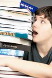 Terrified Teen Looks At Stack Of Textbooks