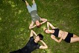 Friends lying and resting on ground
