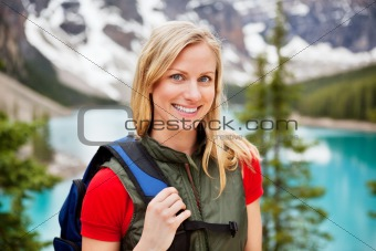 Beautiful female hiker smiling