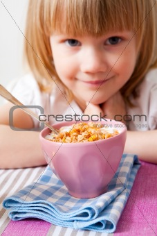 Little girl in breakfast table