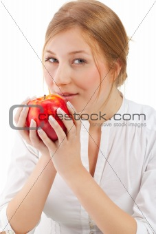 Beautiful woman holding apple