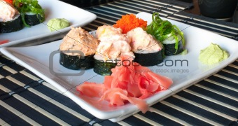 Assorted sushi plate on  plate over bamboo mat