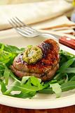 beef steak with arugula salad and pesto