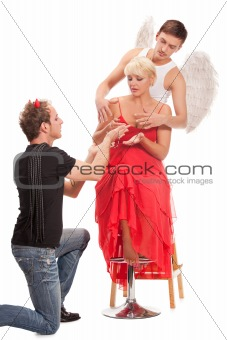 woman  between a beautiful angel and devil