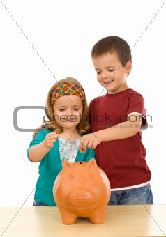 Kids saving coins in large piggy bank