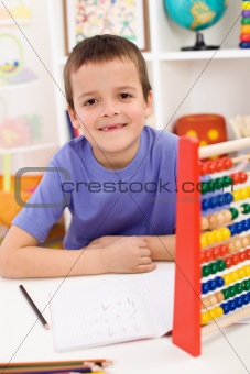 Happy kid solving math exercise