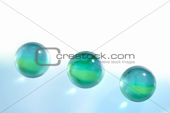 Three glass translucent spheres