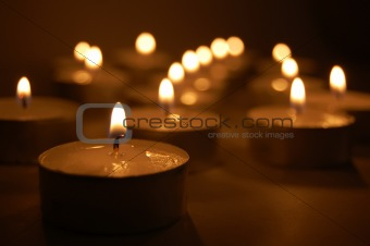 Yellow small candles. Background.