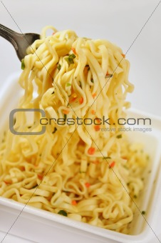 Appetizing Instant noodles with spices. Noodles on a fork