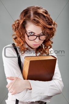 young woman in glasses with a book
