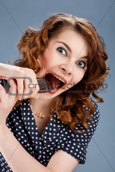 happy smiling woman eating chocolate