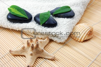 foldet white bath towel and zen stones