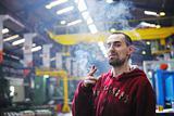 industry worker smoking cigarette