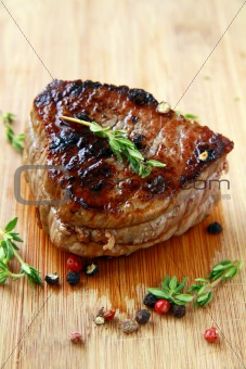 close-up of juicy sirloin beef covered in pepper