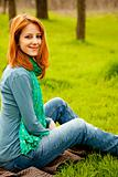 Beautiful red-haired girl sitting 