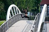 jumping dancer on bridge