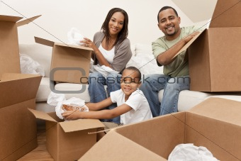 African American Family Unpacking Boxes Moving House