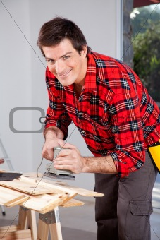 Man with Electric Hand Sander