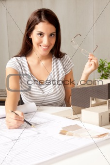 Architect with Blueprints and House Model