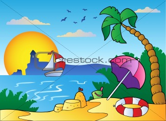 Beach with umbrella and sand castle