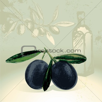 Black olives with olive oil bottle in the background