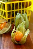 yellow organic physalis on a wooden board