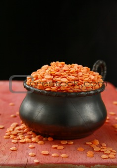 pot of red lentils in a red wooden board