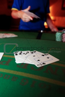 poker player throwing in loosing hand of cards