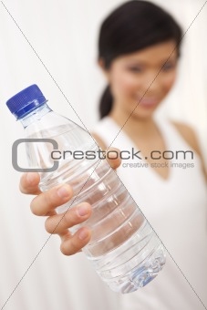 Asian Chinese Girl Holding Bottle of Pure Water to Camera