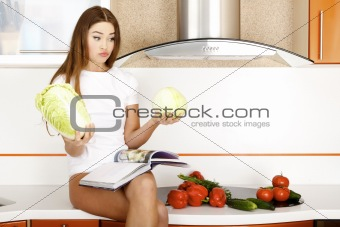 beautiful young woman ready to prerare salad