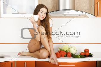 beautiful caucasian woman in the kitchen.