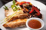 Chicken fillets on roosterkoek with vegetables