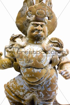 Ancient porcelain figure of a chinese god isolated on white with clipping path