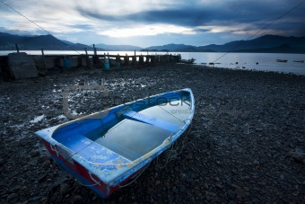 Old fish-boat on beach.