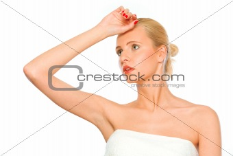 Beautiful girl with hand near forehead looking up