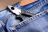 pliers in the jeans' pocket