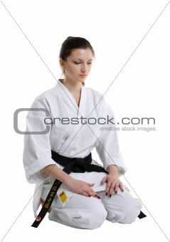Karate. Young girl in a kimono with a white