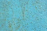 texture of the old rusty metal with a crack of blue