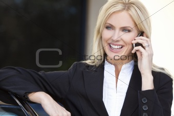 Blond Businesswoman Talking On Her Cell Phone