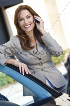 Portrait of Beautiful Woman or Businesswoman On Her Cell Phone