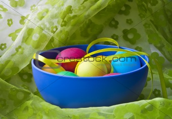 a plate of eggs on green curtains