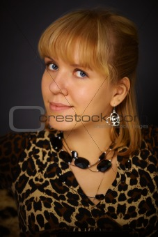 Portrait of beautiful woman in leopard dress