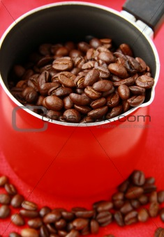 Fresh aromatic coffee beans in a metal coffee pot