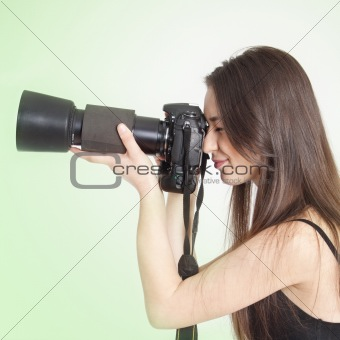 a young female photographer with a professional camera