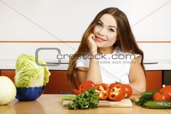 beautiful caucasian woman preparing salad in the kitchen.