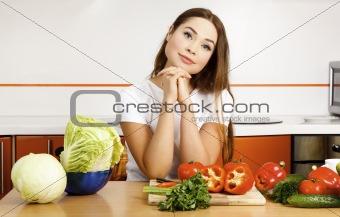 beautiful caucasian woman preparing salad in the kitchen.