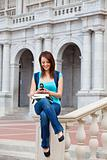 Young woman texting on campus