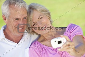 Happy Senior Couple Taking Self Portrait Photograph on Digital C