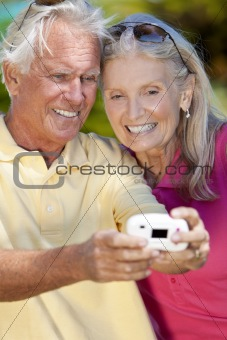 Happy Senior Couple Taking Self Portrait Photograph with Digital